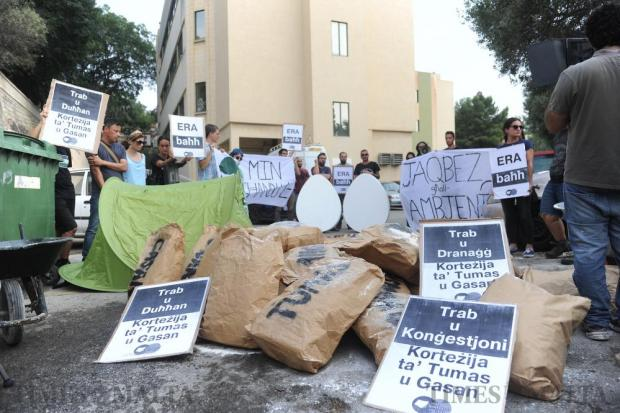 A group of protesters gather in front of the ERA offices in Floriana to show their disapproval over the recent decisions taken by the authorities concerning the environment on August 26. Photo: Steve Zammit Lupi A group of protesters gather in front of the ERA building in Floriana to show their disapproval over the recent decisions taken by the authorities concerning the environment on August 26. Photo: Steve Zammit Lupi