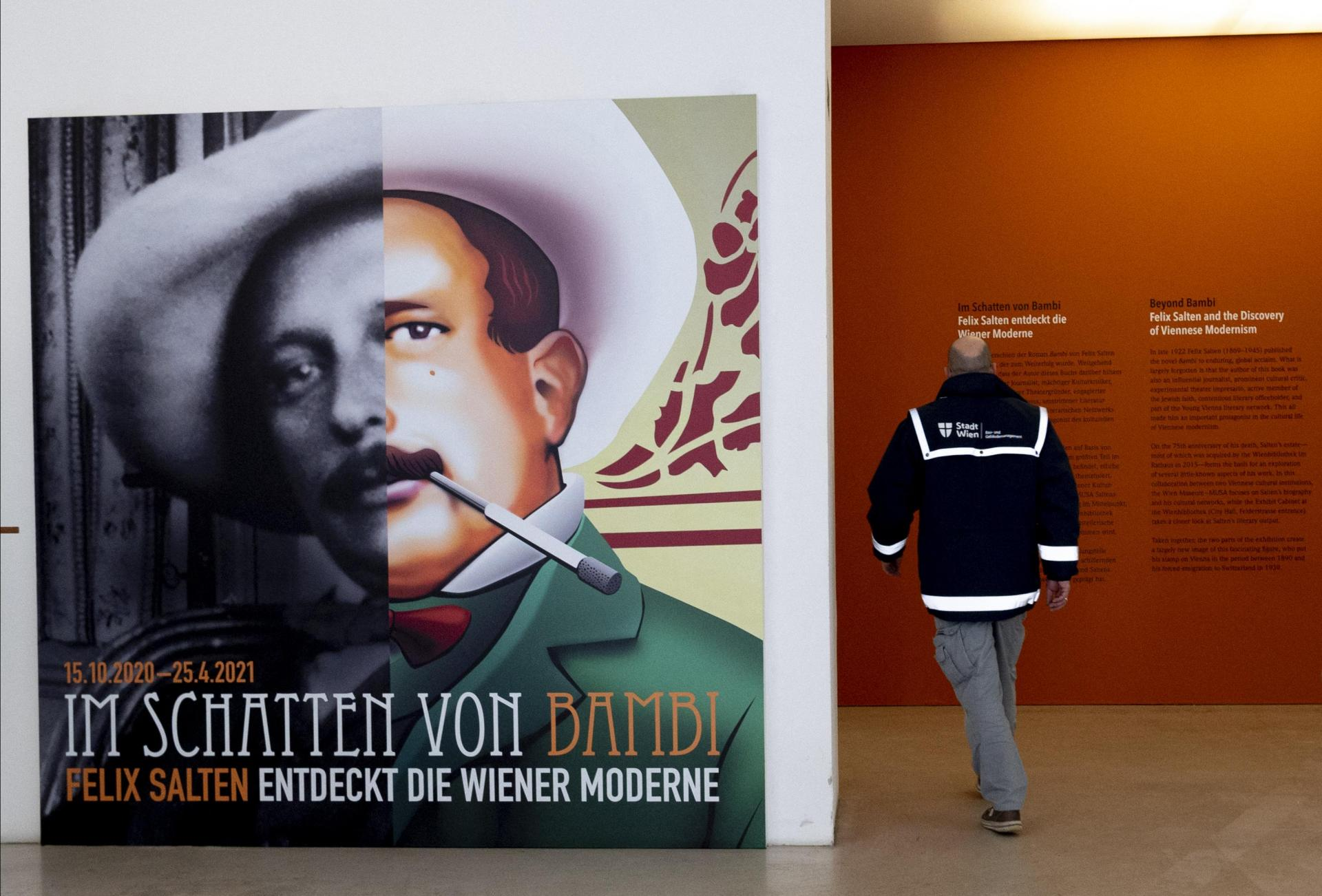 A man passes by a poster of Felix Salten as he enters the exhibition 'Beyond Bambi - Felix Salten and the Discovery of Viennese Modernism'.