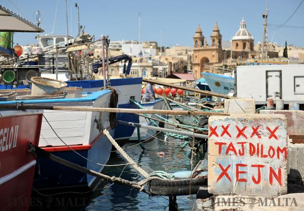 An intriguing message which translates as: Shhhh, Don't tell them anything, is painted on the Marsaxlokk quay on April 18. Photo: Chris Sant Fournier