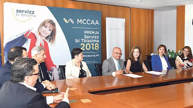 Parliamentary Secretary for Consumer Protection and Valletta 2018, Deo Debattista (fourth from right), addressing the media during the Service With a Smile 2018 Award launch.