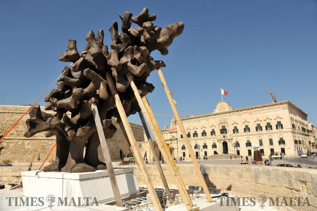 A bronze monument celebrating the endeavours of all those who strove for the creation of the Maltese State is erected in Castille Square, Valletta on March 17. Designed by Valerio Schembri, the monument, in the form of a flame, will be inaugurated by the Prime Minister during a ceremony scheduled for May 12. Photo: Chris Sant Fournier