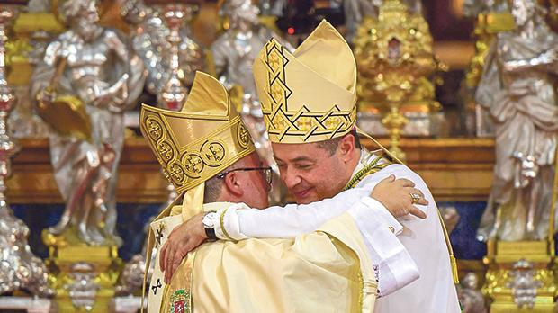 Archbishop Charles Scicluna and Auxiliary Bishop Joseph Galea Curmi embrace after the latter's episcopal ordination. Photo: Curia