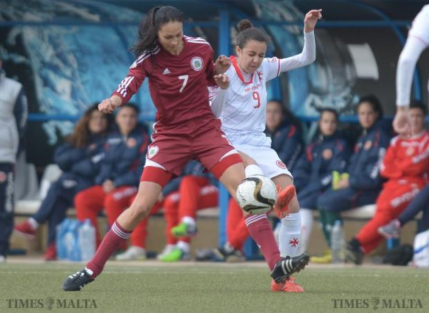 Malta's Martina Borg (right) tries to steal the ball from Latvia's Glina Ozola during soccer friendly at the Centenary Stadium in Ta'Qali on January 19. The Maltese women's national team won the match 3-0. Photo: Matthew Mirabelli