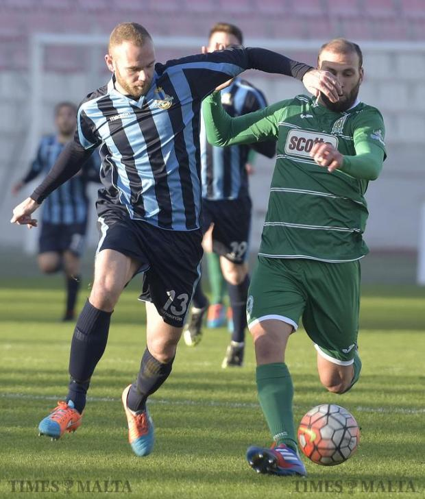 Floriana's Mauricio Villa (right) tackles Clifford Gatt Baldacchino, of Sliema during their Premiership match at the National Stadium in Ta'Qali on January 17. Photo: Mark Zammit Cordina