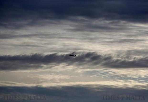A plane gains altitude after taking off from Malta International Airport on March 10. Photo: Darrin Zammit Lupi