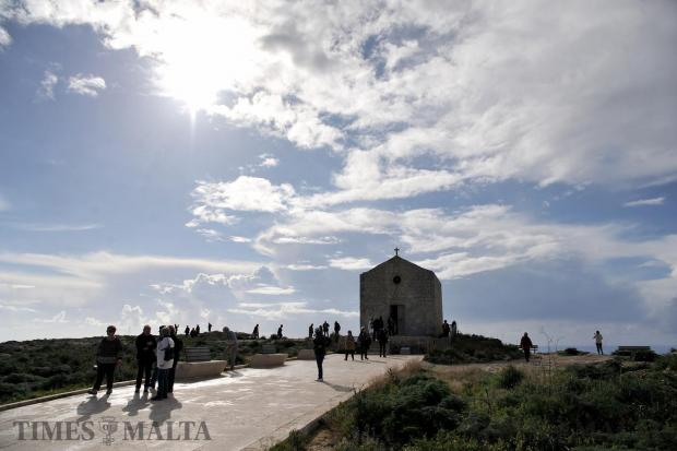 Tourists swarm around a chapel at Dingli Cliffs on January 25. Photo: Chris Sant Fournier