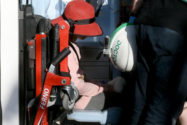 The tree which the tourist bus hit in Żurrieq. An injured child sits in an ambulance on April 9. Photo: Jonathan Borg