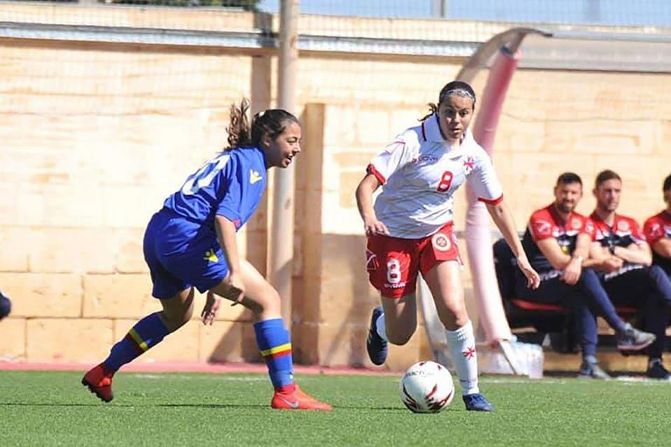 Emma Ciantar Piccinino in action for Malta (right).