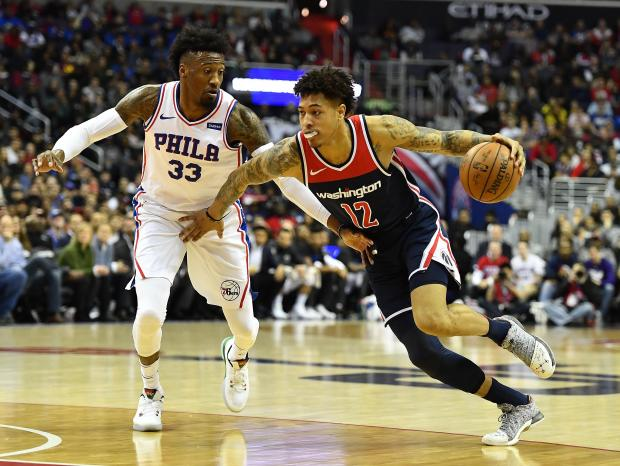 Washington Wizards forward Kelly Oubre Jr. (12) drives past Philadelphia 76ers forward Robert Covington (33) during the first half at Capital One Arena. Photo Credit: Brad Mills-USA TODAY Sports
