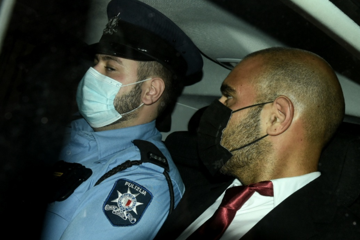 Glen Farrugia, right, arrives in court last week accompanied by a police officer. Photo: Chris Sant Fournier