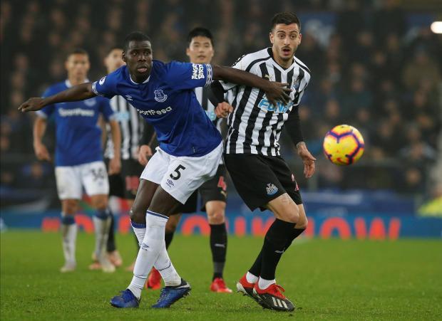 Newcastle United's Joselu in action with Everton's Kurt Zouma.