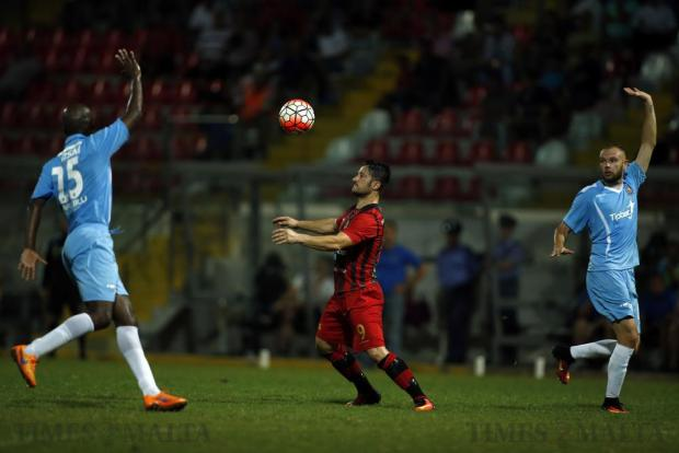 Gzira United's Souleymane Diamoutene (left) and Clifford Gatt Baldacchino (right) call an offside as Hamrun Spartans' Jean Pierre Mifsud Triganza receives the ball during their Premier League football match at the Hibernians Stadium in Corradino on August 27. Photo: Darrin Zammit Lupi