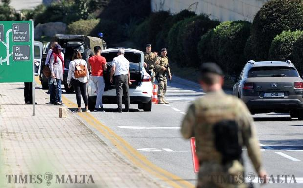 Roads near the airport terminal are reopened after being blocked for more than half an hour because of a bomb alert that turned out to be a false alarm on March 30. Sniffer dogs detected something suspicious in a taxi but army personnel found nothing illegal in a search. Photo: Chris Sant Fournier