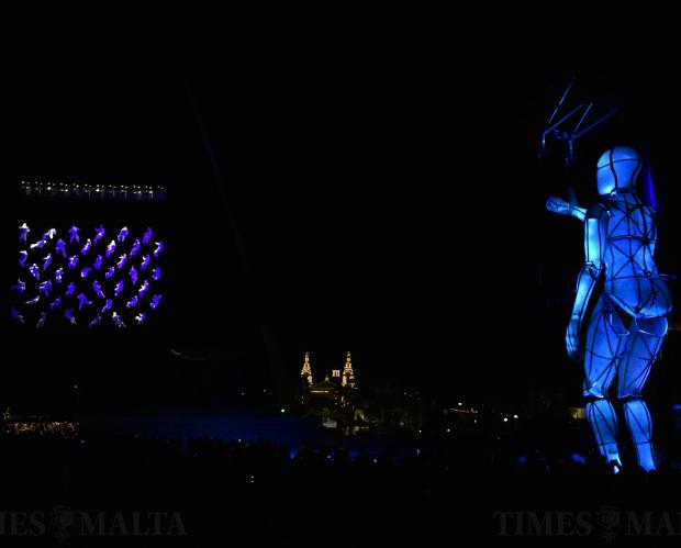 People are suspended in mid-air and a human figure from La Fura dels Baus performs near the Triton Fountain in Valletta during the opening ceremony of the Valletta 18 European Capital of Culture on January 20. Photo: Mark Zammit Cordina