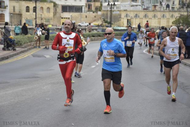 A competitor wearing a Christmas running suit takes part in the 2015 Mdina 2 Spinola Christmas Road Race in St Julian's on December 20. Photo: Mark Zammit Cordina