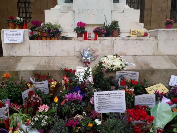 The foot of the monument has served as a shrine to Ms Caruana Galizia for almost a year. Photo: Chris Sant Fournier.