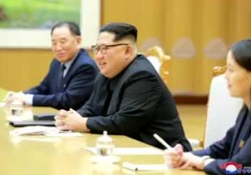 Trump hails N.Korea's 'honorable' Kim but tempers summit expectations