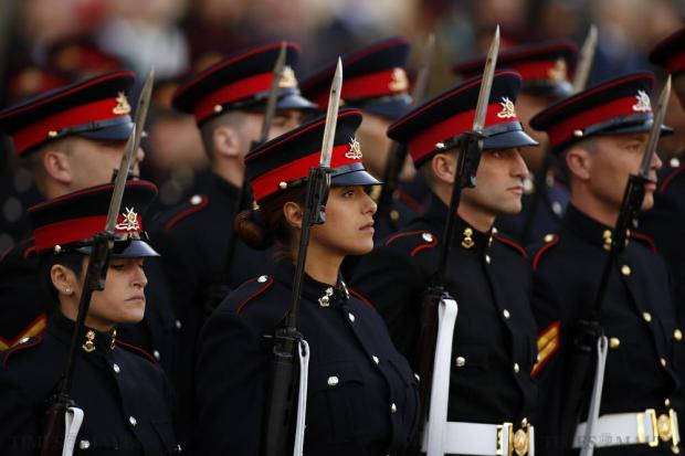 Armed Forces of Malta soldiers march during a military parade to mark Malta's Republic Day in Valletta on December 13. Malta, a former British colony, became a republic in 1974, 10 years after gaining independence. Photo: Darrin Zammit Lupi