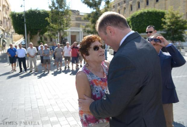 Prime Minister Joseph Muscat is welcomed by a member of the public on arrival at Dock 1 in Cospicua on August 21, after he announced that the buildings would form part of the new American University of Malta project. Photo: Matthew Mirabelli
