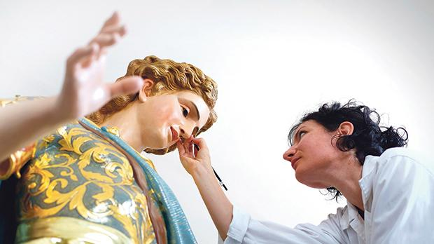 Restorer Maria Grazia Zenzani applies the finishing touches to the statue of St Julian as the 10-month restoration project comes to an end in time for the feast next week. Photo: Marc Aaron Orchard
