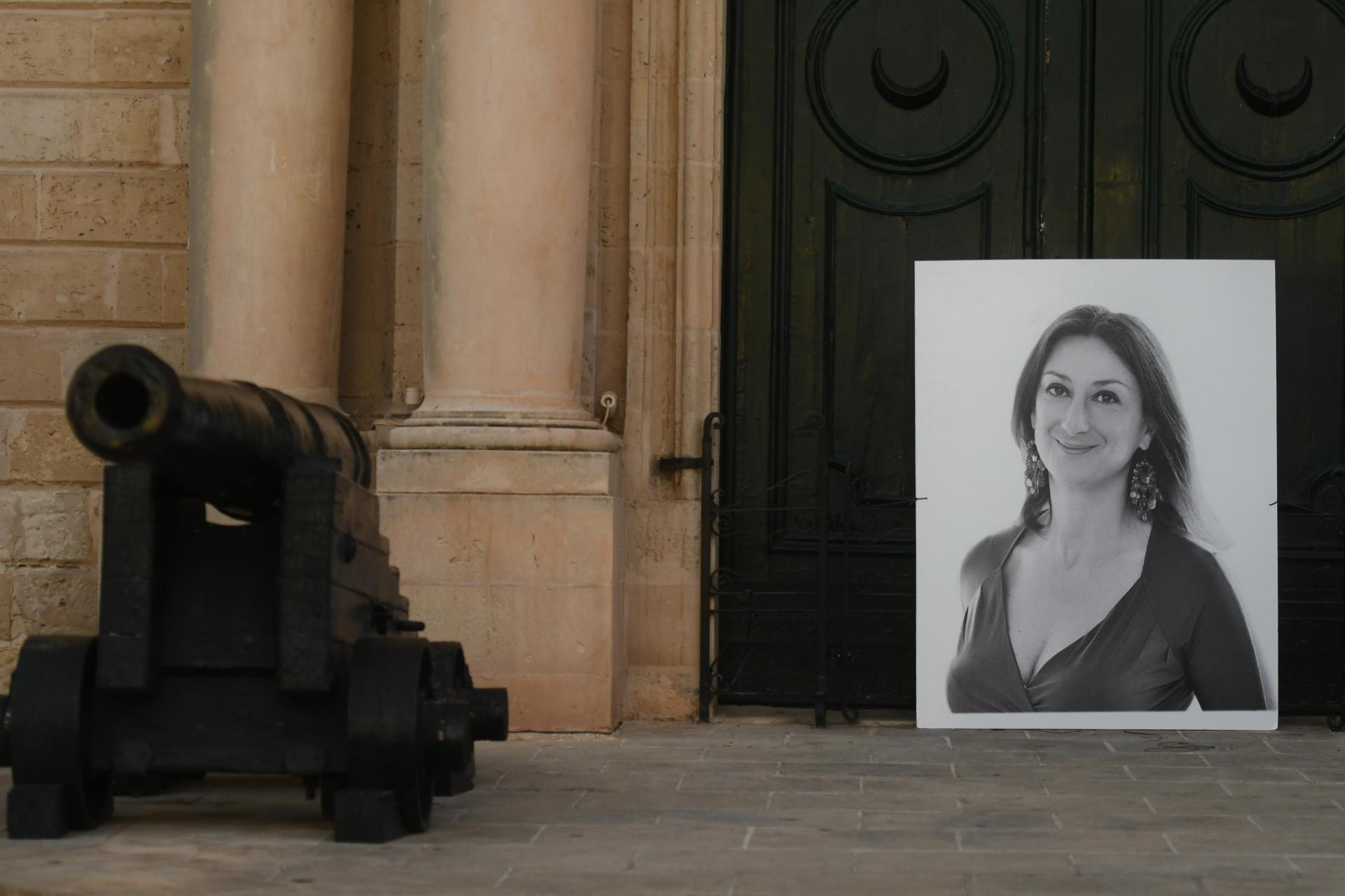 A portrait of Daphne Caruana Galizia rests against the door of the Office of the Prime Minister in Valletta. Photo: Jonathan Borg