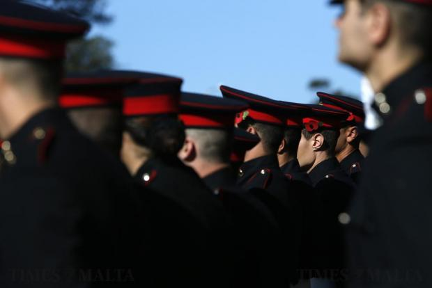 Armed Forces of Malta soldiers wear poppies in their caps during the Remembrance Sunday ceremony at the war memorial cenotaph in Floriana on November 13. Photo: Darrin Zammit Lupi