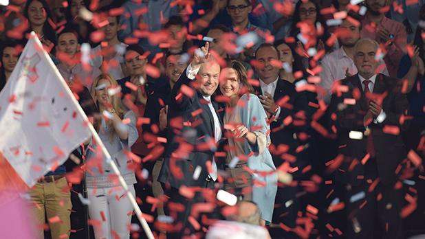 Prime Minister Joseph Muscat and his wife, Michelle, wave to the crowd during a Labour Party mass meeting in Żabbar. Photo: Mark Zammit Cordina