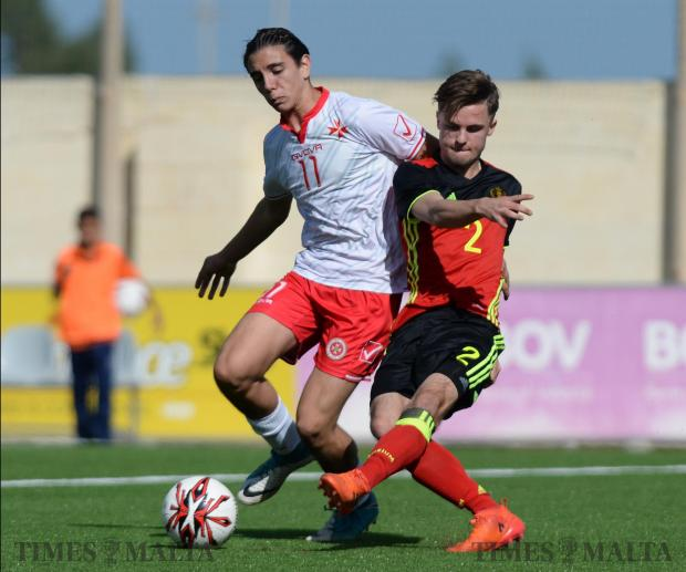 Belgium's Artuur Zutterman, (right) gets a shot passed Malta's Alex Satariano during their UEFA U17 Championship at the Centenary Stadium in Ta'Qali on October 26. Photo: Matthew Mirabelli