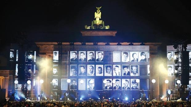Musicians play drums in front of the Brandenburg Gate in Berlin yesterday during a commemoration of people who died while trying to cross the Berlin Wall to escape from former East Germany. Photo: Reuters
