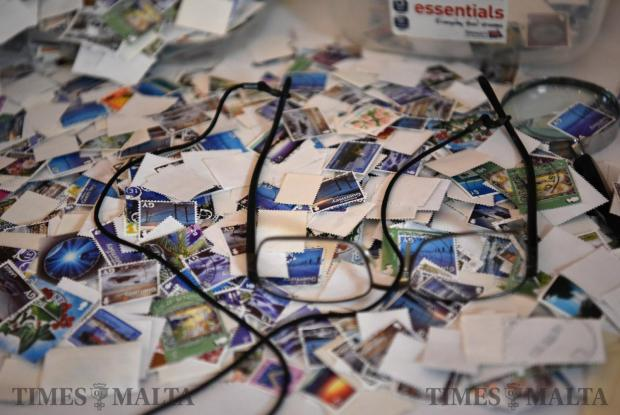 Various stamps are piled up on a table during a stamp display at the Kazin Malti in Valletta on October 12. Photo: Mark Zammit Cordina