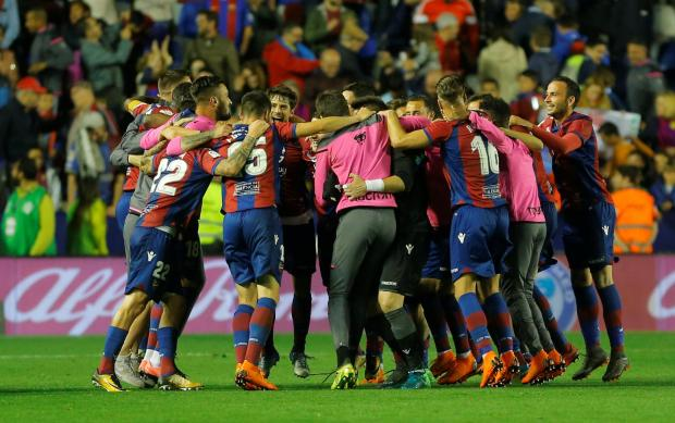 Levante players celebrate after the match.