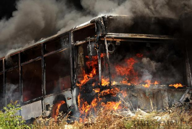 A bus catches fire in a dis-used vehicle facility in San Gwann on June 21. Photo: Chris Sant Fournier