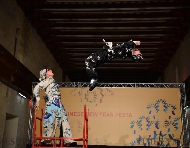 A performer from China's Zhejiang Wu Opera Troupe does a backflip during the Chinese new year celebrations held in Valletta on February 14. Photo: Mark Zammit Cordina