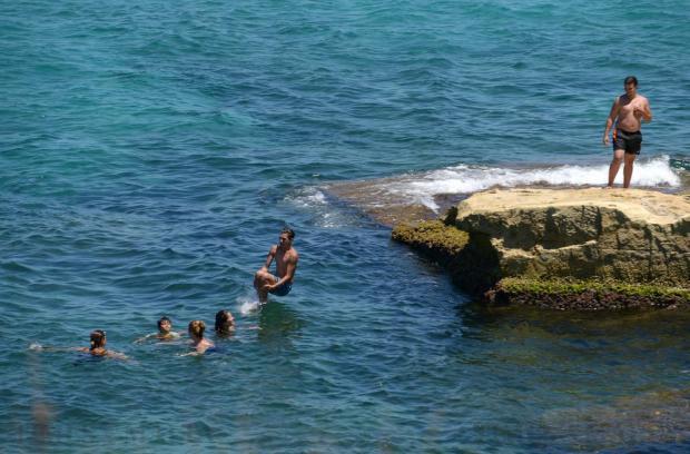 A man jumps into the sea in Baħar iċ-Ċagħaq on July 19. Photo: Matthew Mirabelli