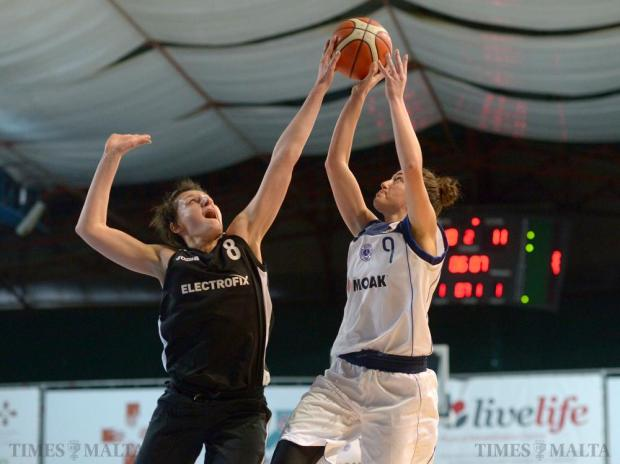 Caffe Moak Luxol and Hibernians Electrofix players battle it out in the St James Hospital Cup final at the Basketball Pavilion in Ta' Qali on January 31. Photo: Matthew Mirabelli