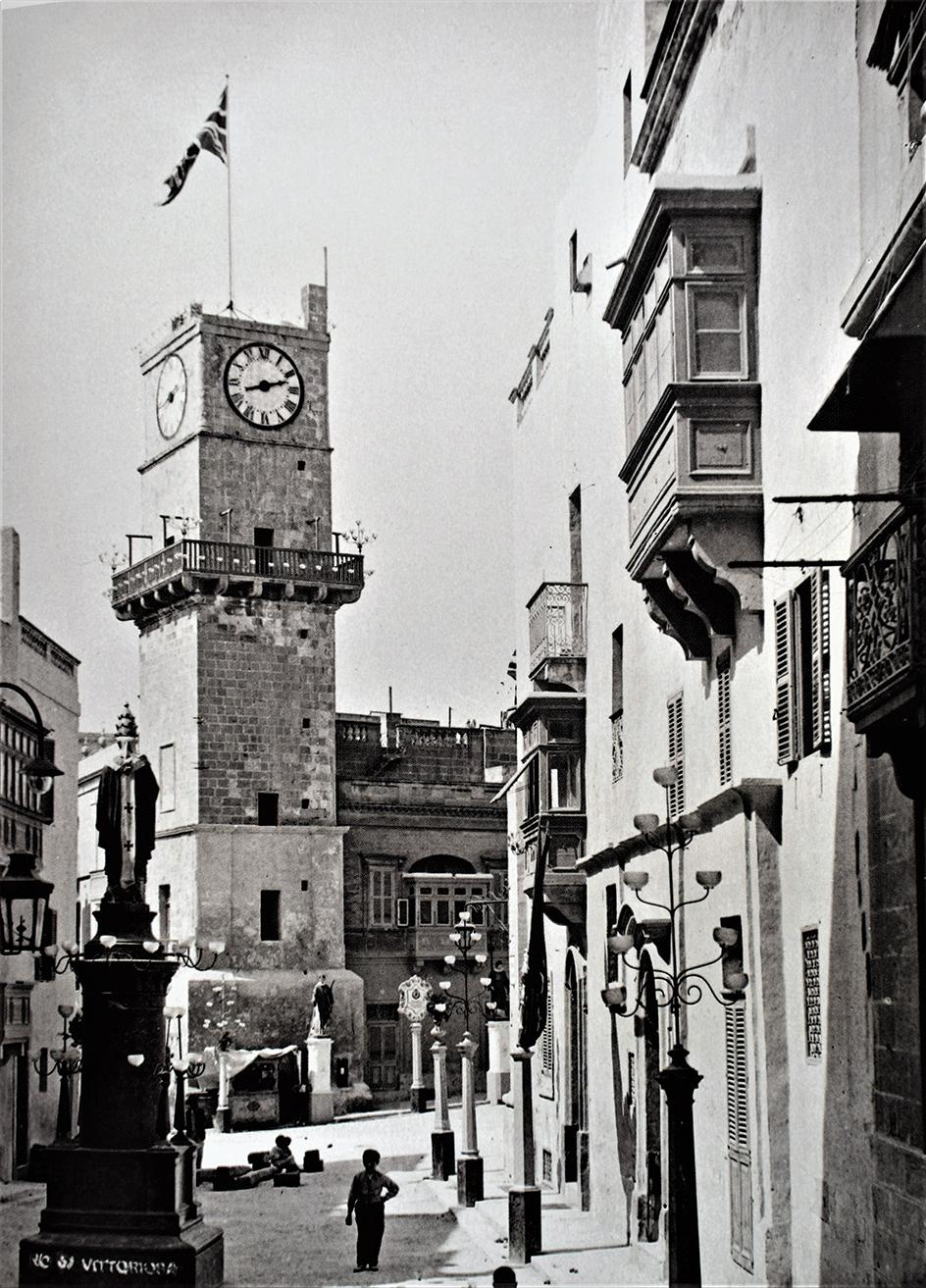 The ancient clock tower in Vittoriosa, which was badly damaged in World War II, shown during a religious festa. Photo: Richard Ellis