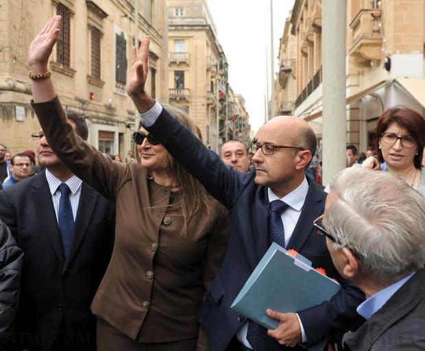 Shadow Justice Minister Jason Azzopardi and his wife acknowledge the cheers and applause from the hundreds of people who turned up to show their support outside the law courts in Valletta on April 6. Jason Azzopardi is charged with defamation, having accused former police commissioner Peter Paul Zammit of leaking a police file to the media last June. Photo: Chris Sant Fournier