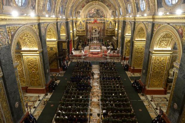 Army personal attend a mass at St John's Co-Cathedral, Valletta on January 16. The ceremony marks the deposition of the army's old colours and sees the AFM's blue standards, which are no longer in use, being presented to the Church to be placed alongside other old banners at the co-cathedral. Photo: Matthew Mirabelli