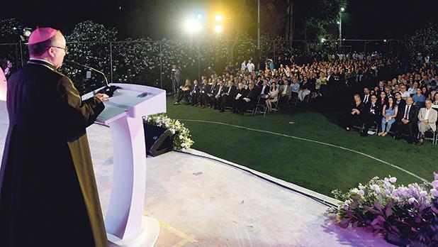 Archbishop Charles Scicluna speaking at the Caritas graduation ceremony.