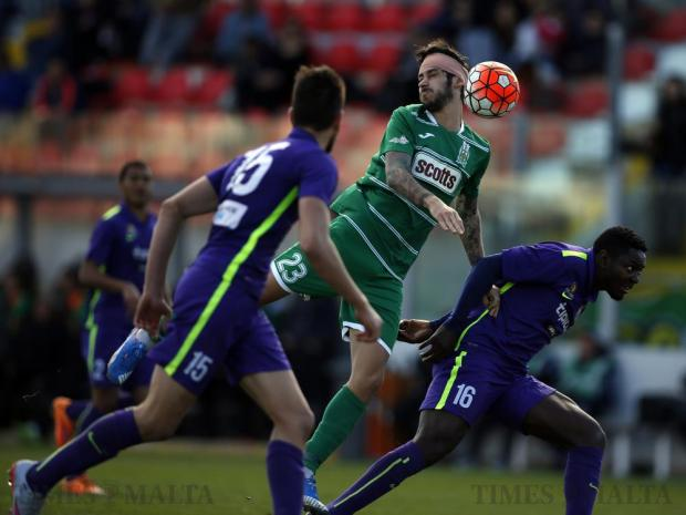 Floriana's Matteo Piciollo (centre) fends off a challenge by St Andrew's Eloy Nkene (right) during their Premier League football match at the Hibs Stadium in Corradino on March 12. Photo: Darrin Zammit Lupi