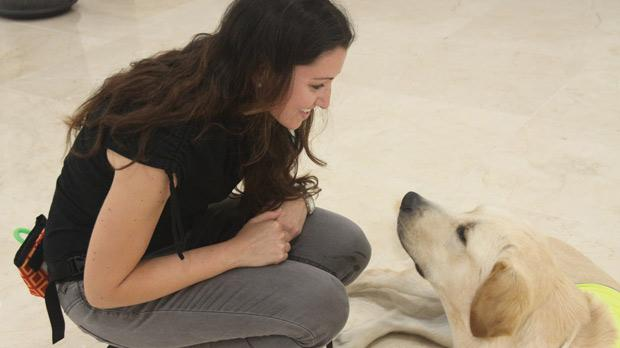Lindsey Ciantar with a guide dog.
