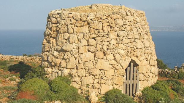 A high girna in the innermost part of the area known as 'Id-Dahar', half an hour's walk beyond the Red Tower.
