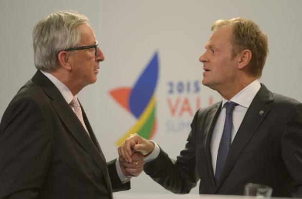 European Commission President Jean-Claude Juncker (left) speaks with European Council President Donald Tusk during a press conference after an informal European Council meeting following the European Union - Africa Summit on the refugee crisis on November 12. Photo: Matthew Mirabelli