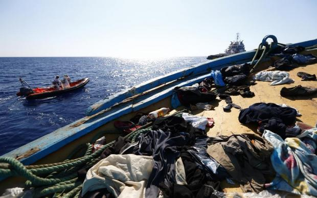 Migrants' belongings litter the deck of a wooden boat from which migrants were rescued 10.5 miles (16 kilometres) off the coast of Libya on August 6. An estimated 600 migrants on the boat were rescued by the international non-governmental organisations Medecins san Frontiere (MSF) and the Migrant Offshore Aid Station (MOAS) without loss of life on Thursday afternoon, according to MSF and MOAS, a day after more than 200 migrants are feared to have drowned in the latest Mediterranean boat tragedy after rescuers saved over 370 people from a capsized boat thought to be carrying 600. Photo: Darrin Zammit Lupi