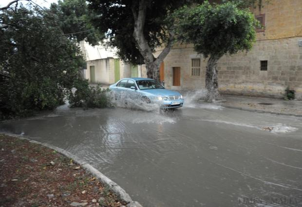 A car drives through the floodwater in Balzan after heavy rain and strong winds hit the island over the weekend, causing trees to fall and flooding in several areas, on October 5. Photo: Matthew Mirabelli