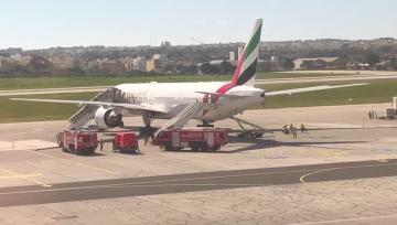 Watch: Brief airport emergency as smoke seen coming out of plane | Fire trucks circle the plane.