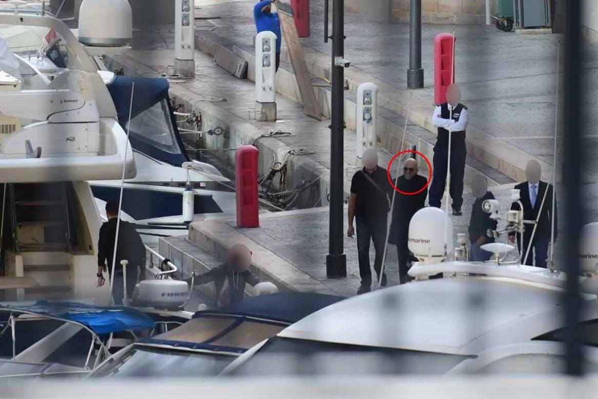Yorgen Fenech (circled in red) with investigators at Portomaso marina on Friday morning. Photo: Jonathan Borg