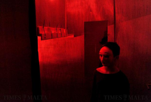 A girl wearing a mask intends to spook people in a horror house in Swieqi on Halloween on October 31. Photo: Chris Sant Fournier