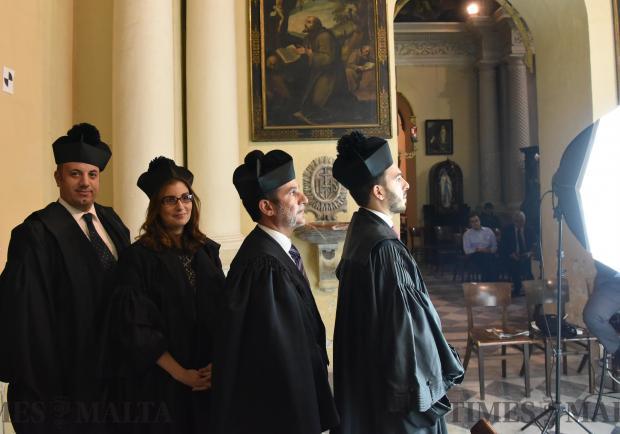 Graduates wait in line to take their photos during their Graduation in Valletta on November 30. Photo: Mark Zammit Cordina