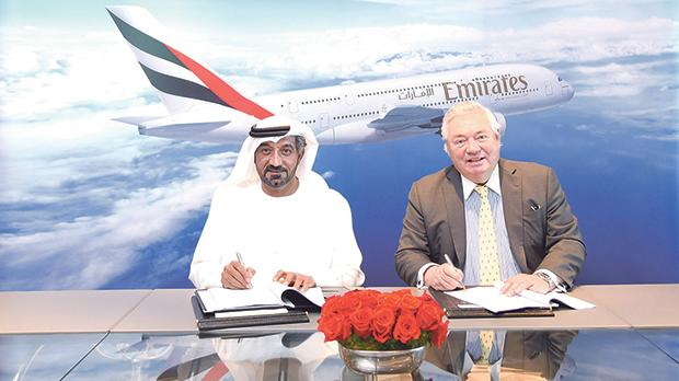 Sheikh Ahmed bin Saeed Al Maktoum, chairman and chief executive, Emirates Airline and Group, signing the agreement with John Leahy, chief operating officer customers, Airbus Commercial Aircraft.